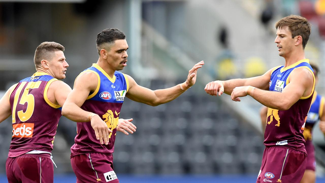 Brisbane Lions forward Charlie Cameron dominated the opening half, but a late surge from the Fremantle Dockers set up a thrilling finish.