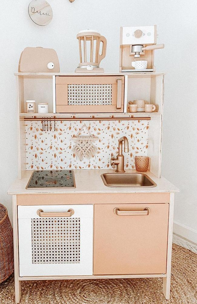Ms Hearnshaw transformed this Ikea kitchen play set in a day using paints, wallpaper and rattan inserts from eBay. Picture: Instagram/@skyzi