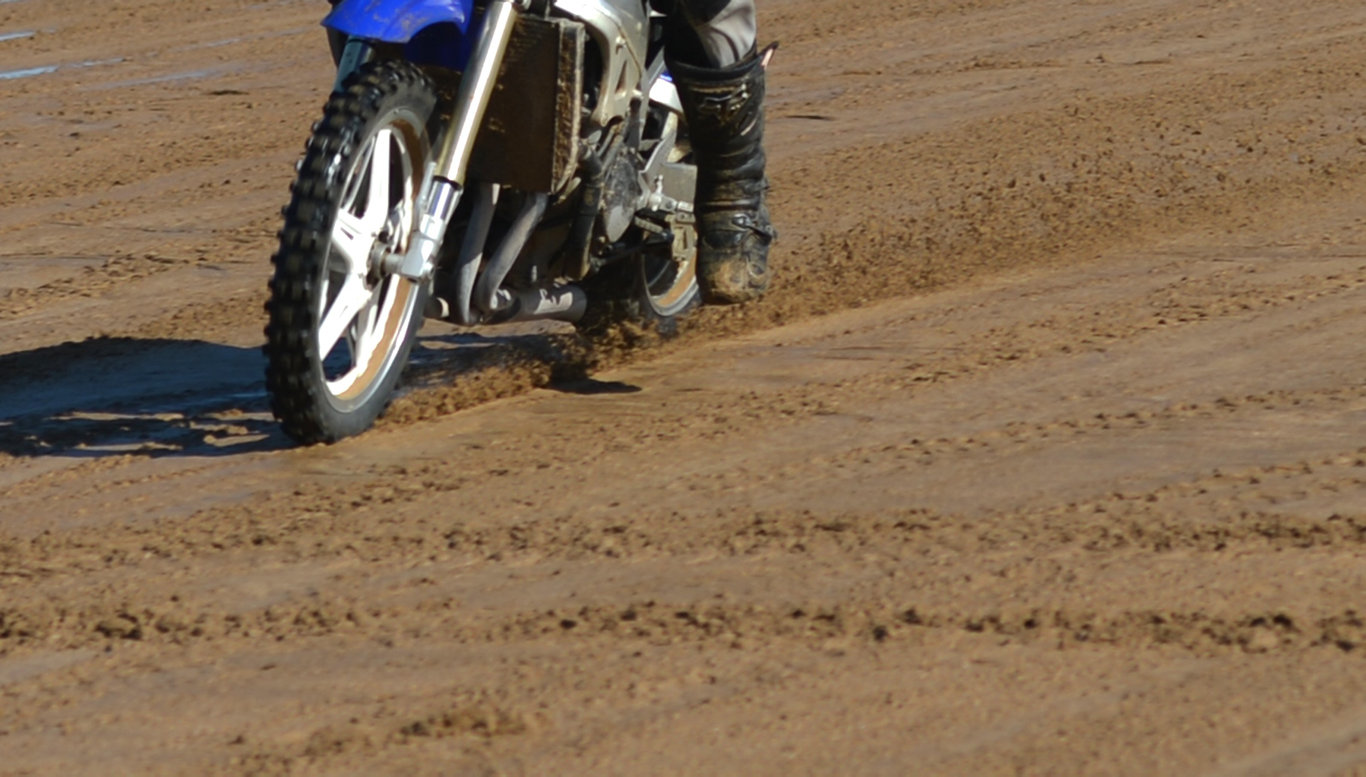 dirtbike rider on the beach.Photo Lee Constable / Daily Mercury