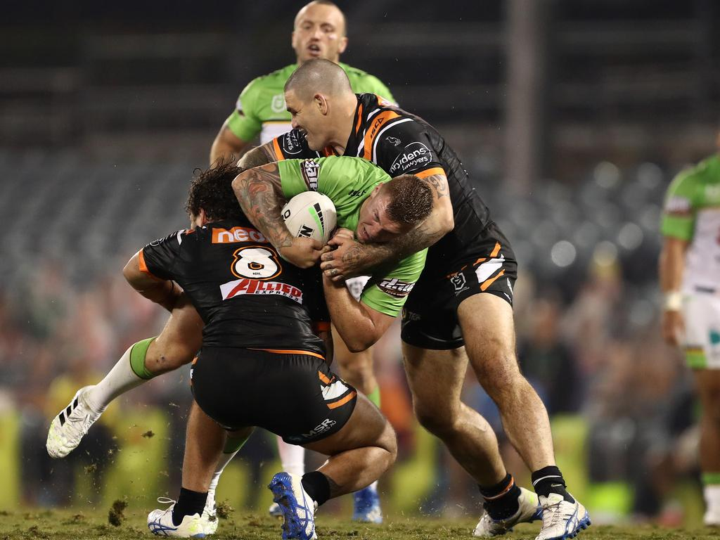 Russell Packer (right) tackles Canberra's Ryan Sutton at Campbelltown Stadium. Picture: AAP Image/Brendon Thorne