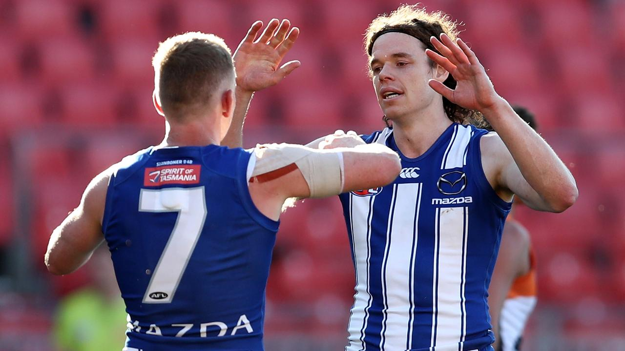 Ben Brown and Jack Ziebell celebrate a goal in the Kangaroos' win.