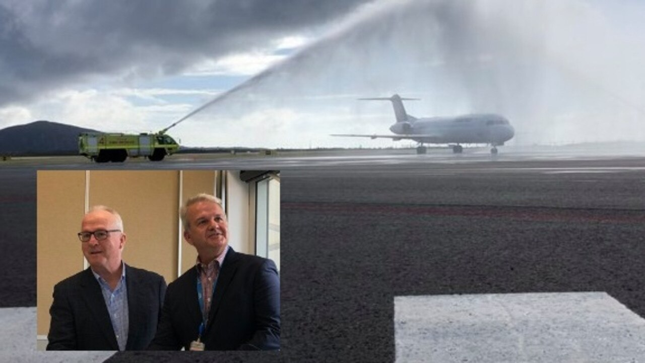 Mayor Mark Jamieson and Sunshine Coast Airport CEO Andrew Brodie welcome the first flight to arrive on the new internationally capable runway.