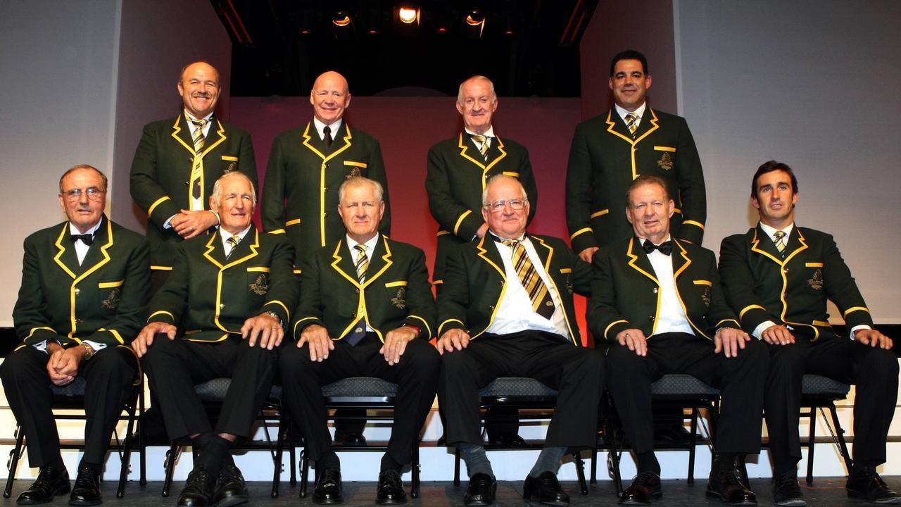 Noel Kelly (jacket undone, tie) is a member of rugby league's Team of the Century.