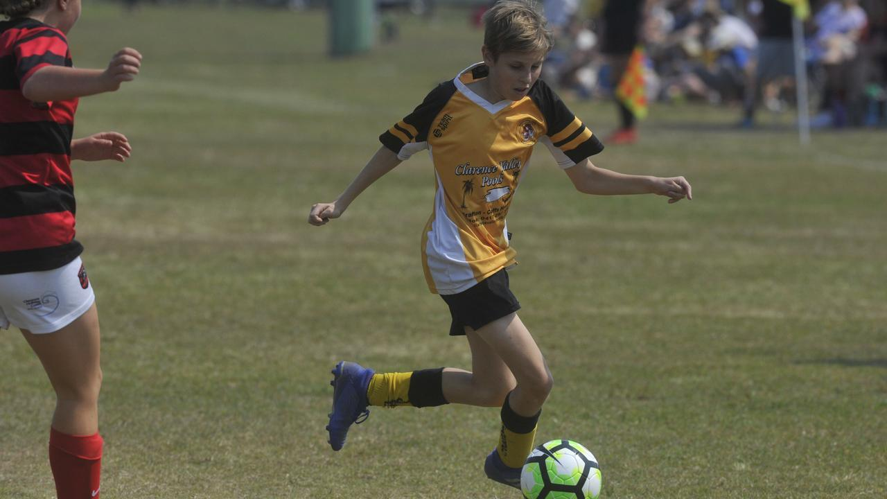 Westlawn Tigers' Koby Holland takes the ball against Yuraygir United in the 13s grand final at Yamba in 2019.