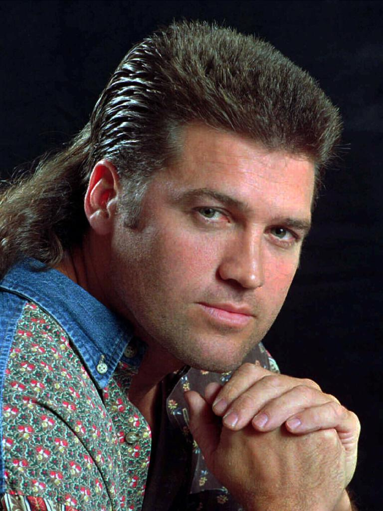 Miley's dad, singer Billy Ray Cyrus, and his glorious mullet in 1994. Picture: AP
