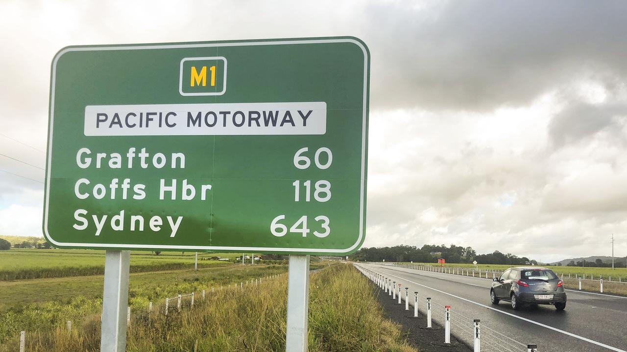 Distance sign on new Pacific Motorway just south of Maclean showing distance to Grafton 60km, when it is around 43km turning off at Tyndale exit.