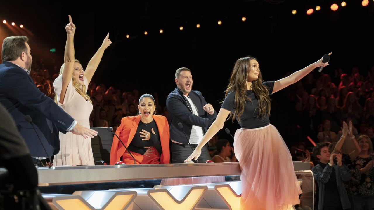 Australia's Got Talent host Ricki-Lee Coulter uses the golden buzzer. Pic: Channel 7