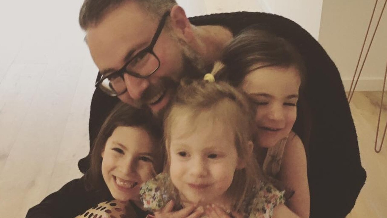 Darren Levin and his three daughters. Picture: supplied
