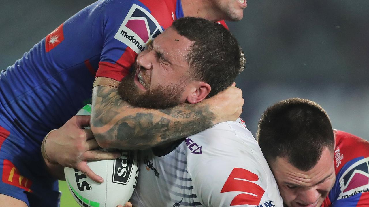 GOSFORD, AUSTRALIA - JUNE 13: Kenneath Bromwich of the Storm is tackled during the round five NRL match between the Newcastle Knights and the Melbourne Storm at Central Coast Stadium on June 13, 2020 in Gosford, Australia. (Photo by Matt King/Getty Images)