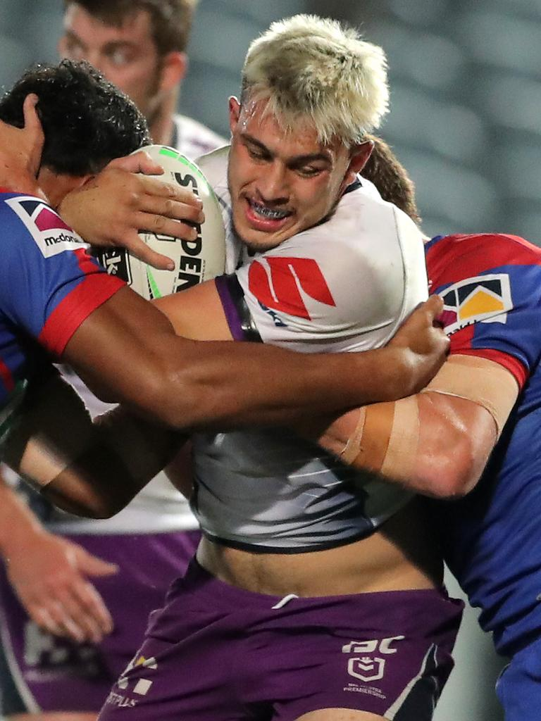 Storm's Tino Faasuamaleaui is a handful for the Newcastle Knights defence. (Photo by Matt King/Getty Images)