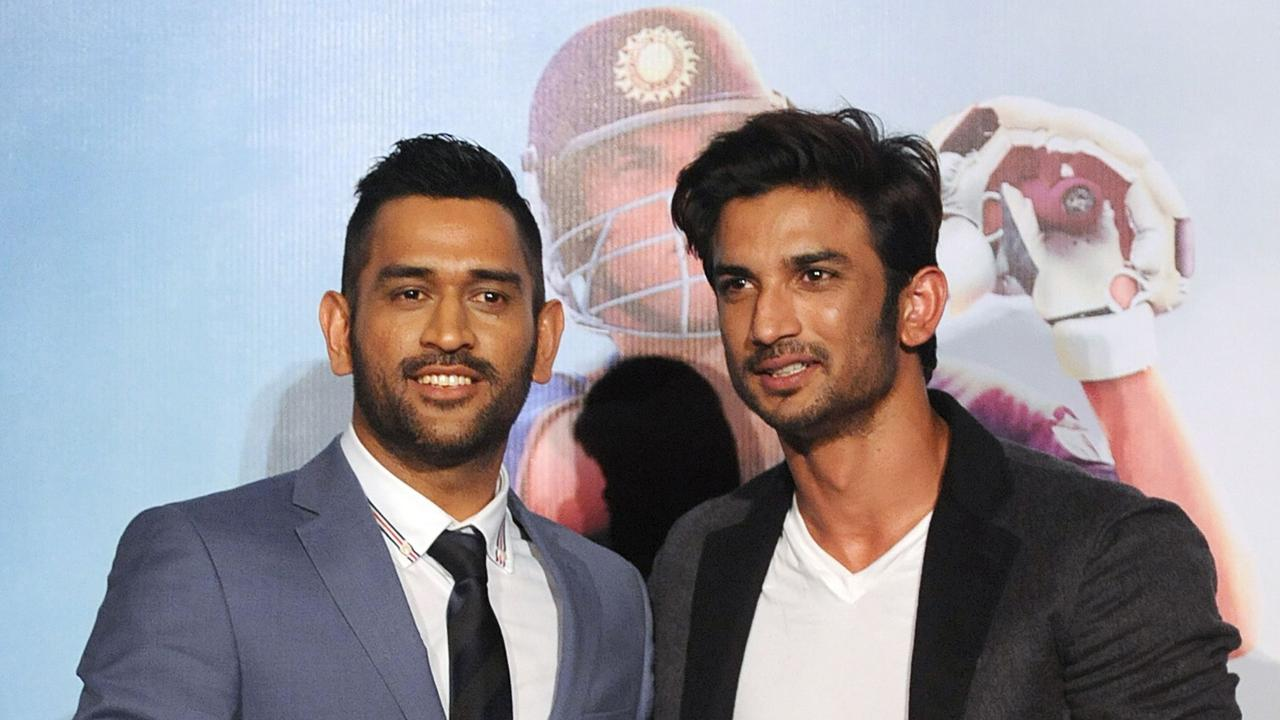 Indian cricketer Mahendra Singh Dhoni poses with Bollywood actor Sushant Singh Rajput.