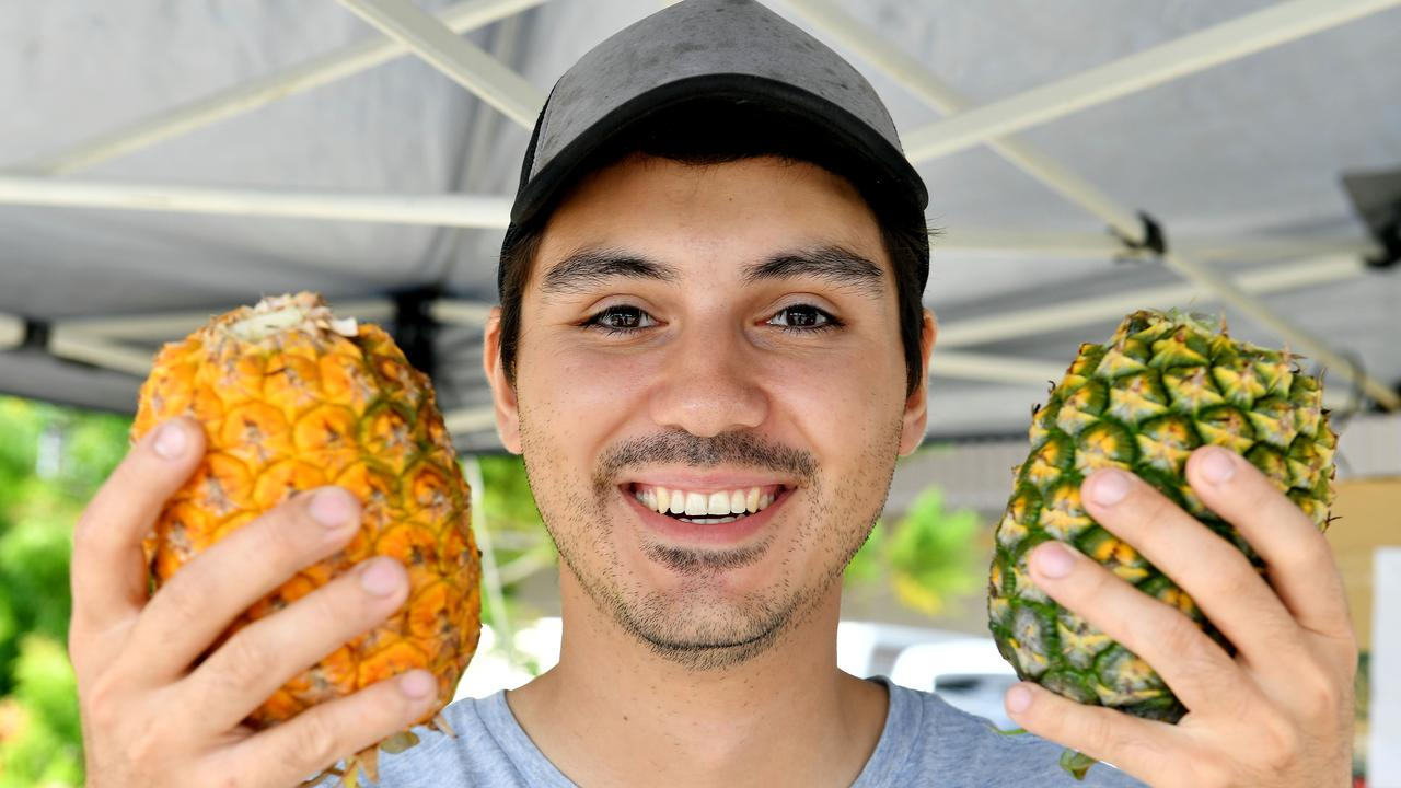 Dario Sarullo with some pineapples that were for sale at the Greater Whitsunday Farmers Market The pineapples were grown on Zelenka's farm at Alligator Creek and Koumala. Picture: Tony Martin