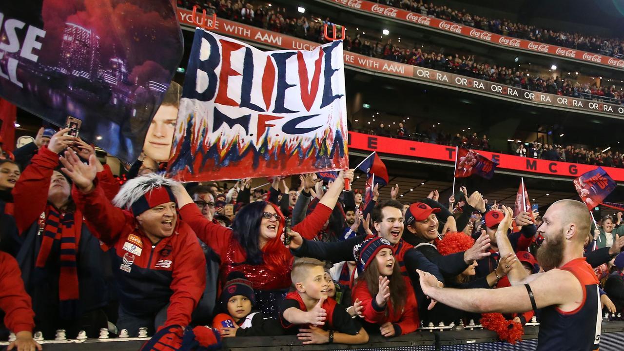 MELBOURNE, VICTORIA – SEPTEMBER 07: Demons fans in the crowd react as Max Gawn of the Demons leaves the field after winning the AFL First Elimination Final match between the Melbourne Demons and the Geelong Cats at the Melbourne Cricket Ground on September 7, 2018 in Melbourne, Australia. (Photo by Scott Barbour/AFL Media/Getty Images)