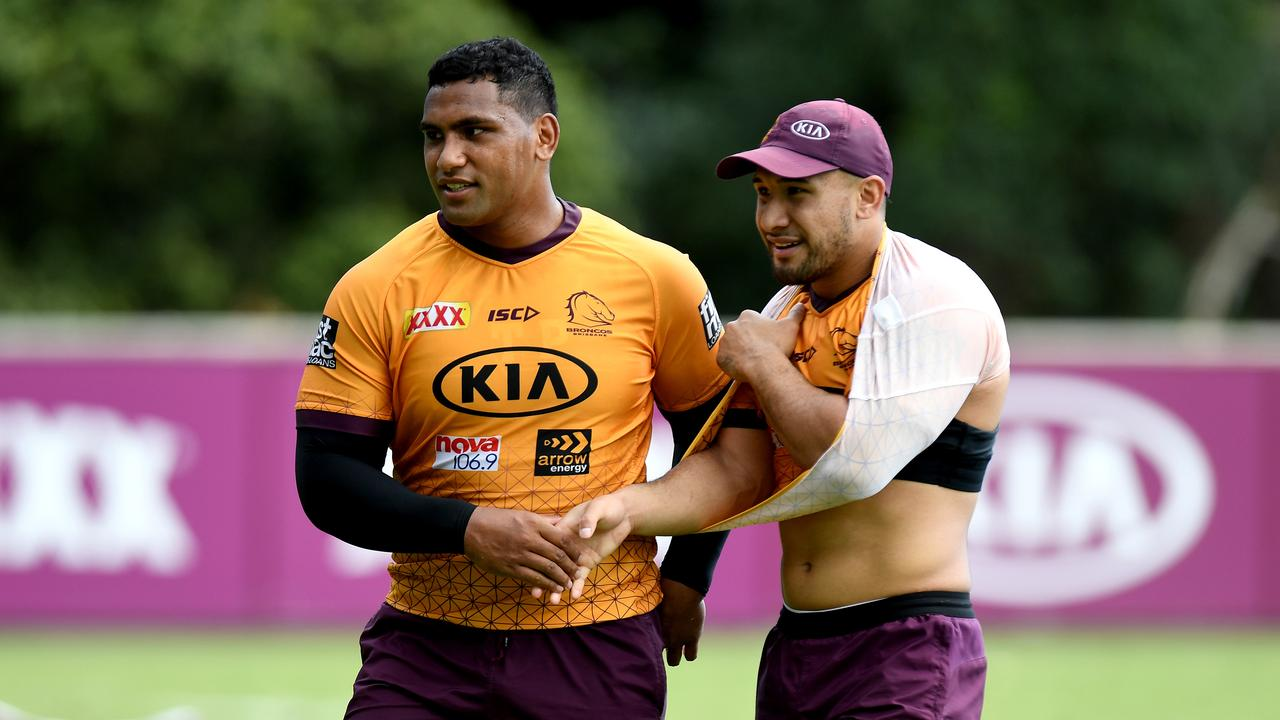 Tevita Pangai Junior (L) cuts an imposing figure at Broncos training. Picture: Getty