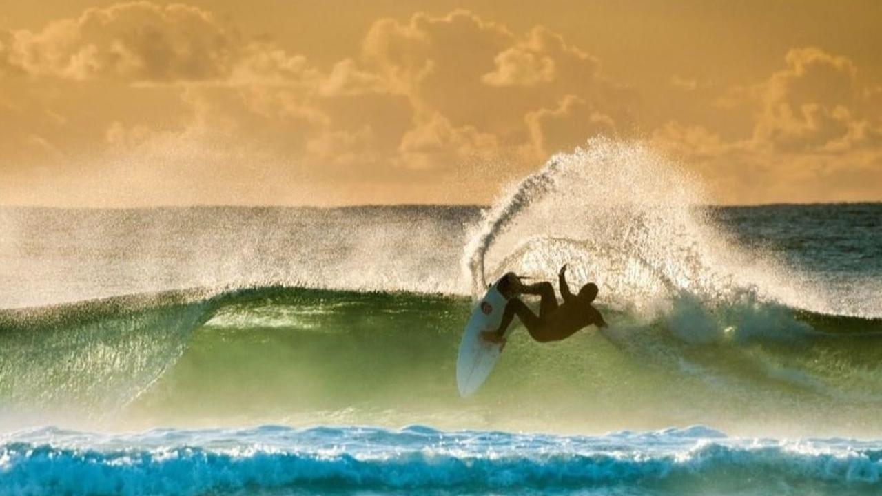 Brendan Margieson in the surf.