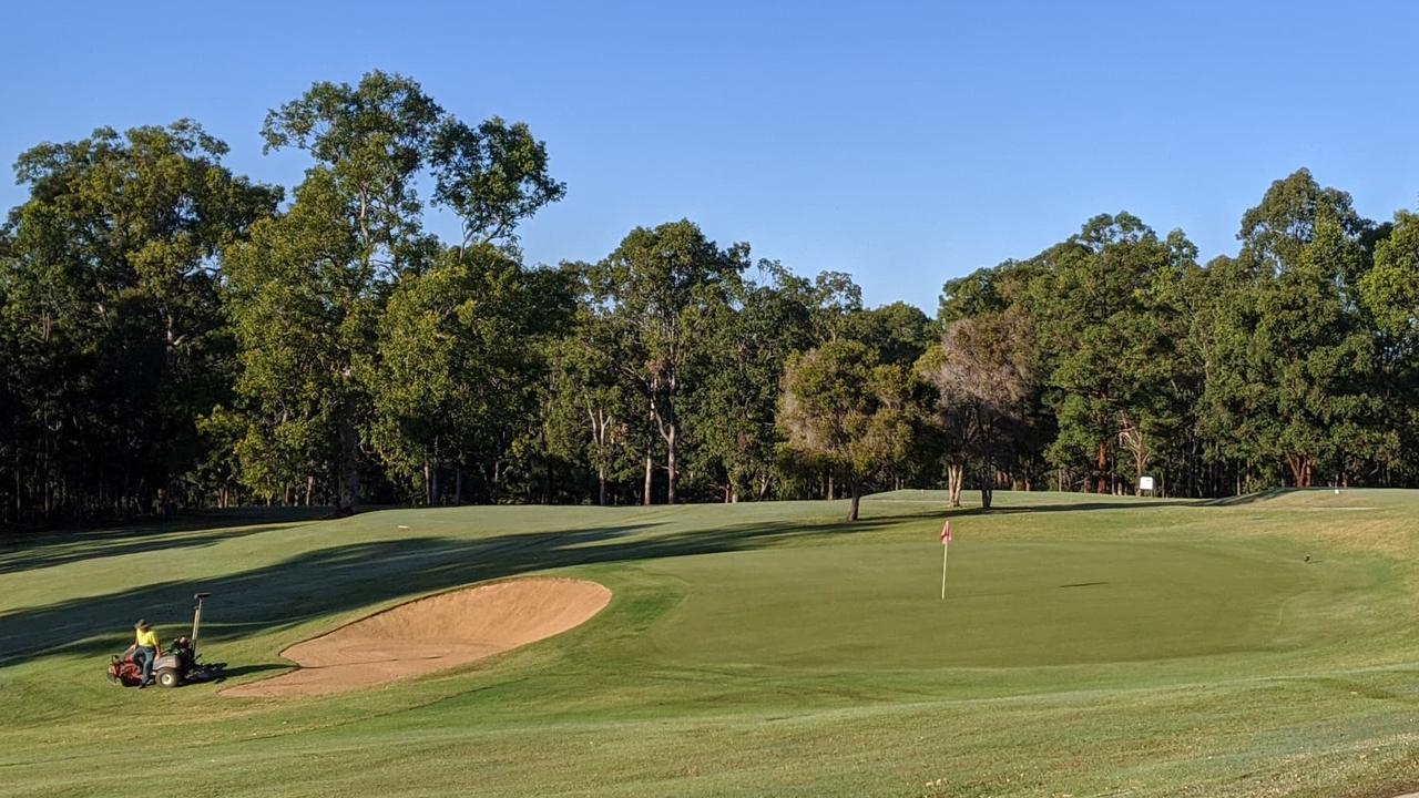HARD YAKKA: Grafton District Golf Club groundskeepers have been hard at work keeping the course in pristine condition including the top-notch 10th hole.