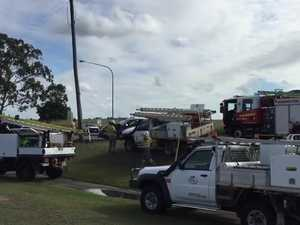 Emergency services and Ergon crews at crash site