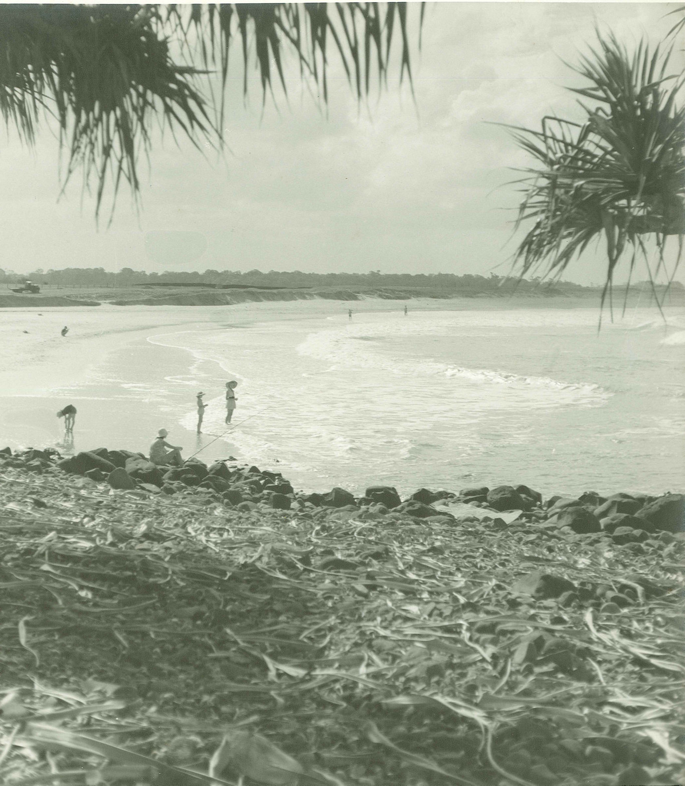Beachgoers at Mon Repos during the 1950s. Note the broad-brimmed hats and elegant bathing costumes.