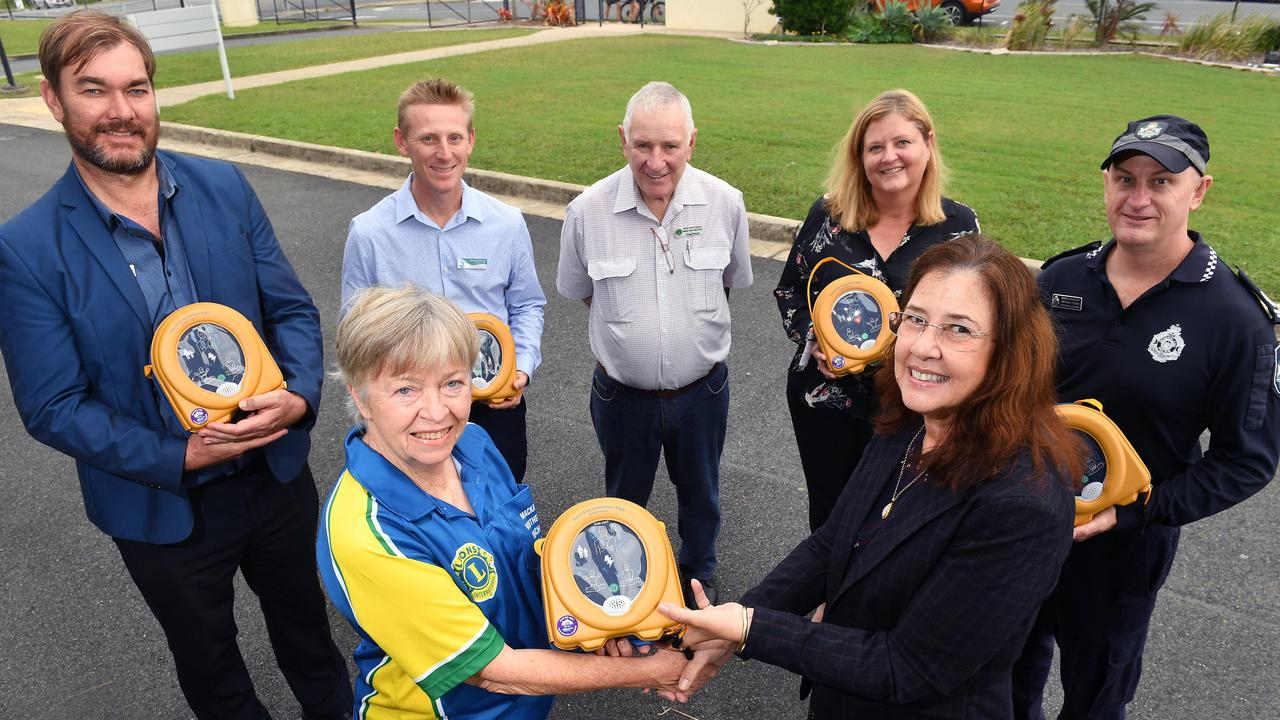 Mackay Northern Beaches Lions Club secretary Marg Cover presents a defibrillator to Bucasia State School principal Belinda Eckford along with Eimeo Road State School deputy principal Cameron Brown, Northern Beaches deputy principal Matthew Grieger, outgoing Northern Beaches Lions Club secretary Doug Petersen, St Brendan's Catholic Primary School assistant principal Shaye Gaviglio and Mackay North