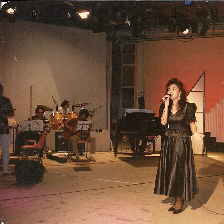 SINGING QUEEN: Lynda Teh-Ogden performing back in the 80s. Photo Contributed
