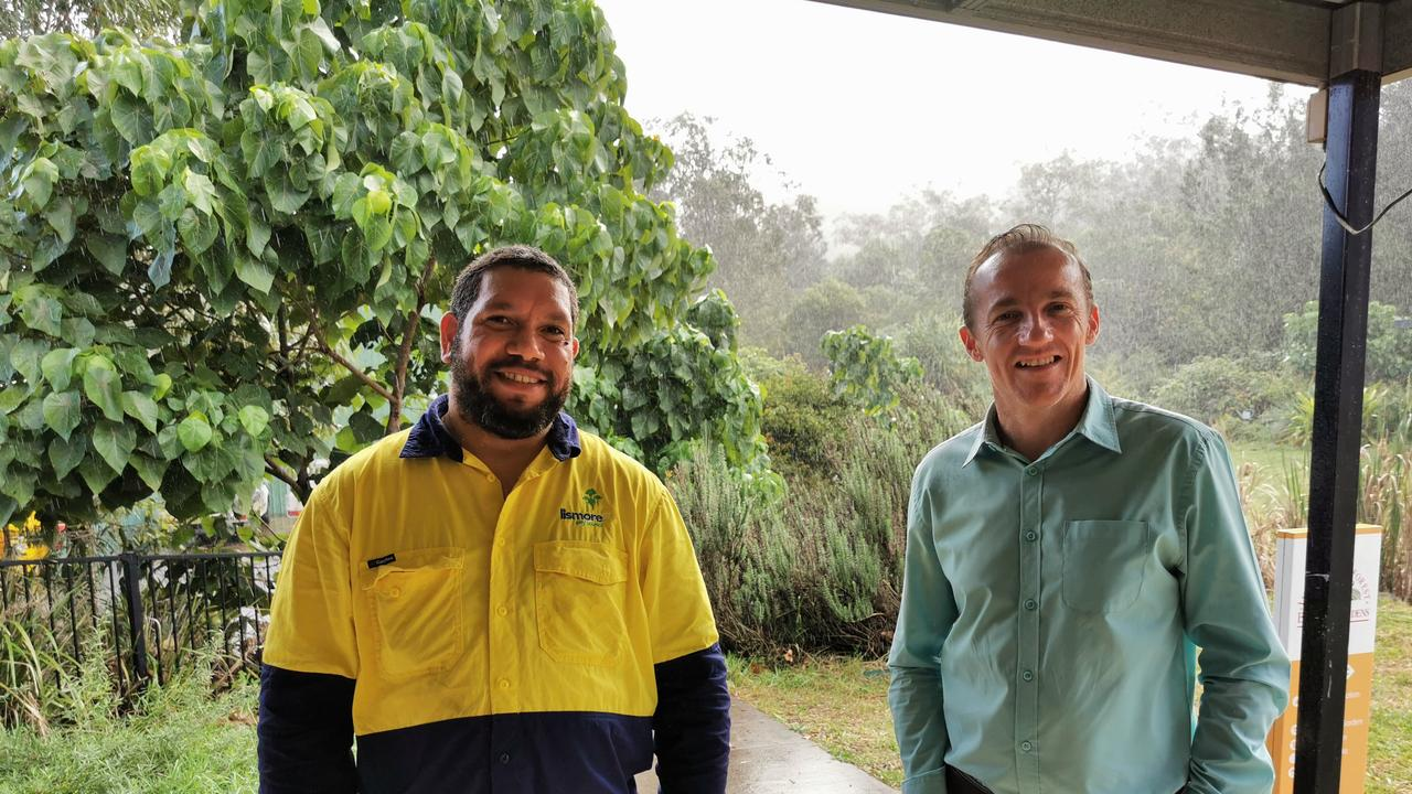 CELEBRATE: Lismore City Council mayor Isaac Smith with Lismore recycling and waste worker Raymond.