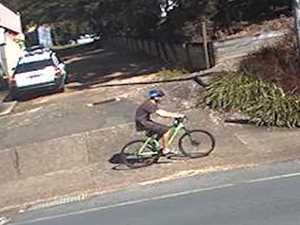Cyclist spits at woman through car window