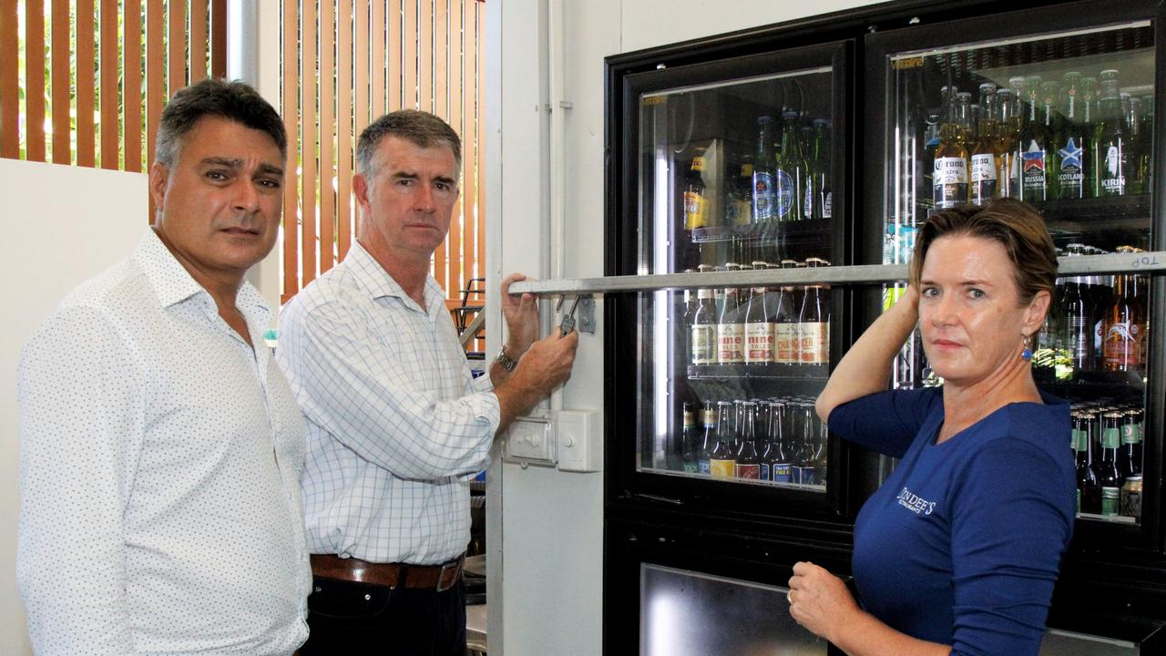 Dundees Cairns Aquarium manager Tina Wort shows LNP Cairns electorate candidate Sam Marino (left) and deputy LNP leader Tim Mander extra security measures to keep thieves out of the Florence St business. Picture: PETER CARRUTHERS