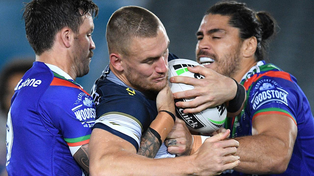 Coen Hess of the Cowboys is tackled by Wayde Egan (left) and Tohu Harris of the Warriors during the Round 5 NRL match between the New Zealand Warriors and the North Queensland Cowboys. (AAP Image/Dan Himbrechts)