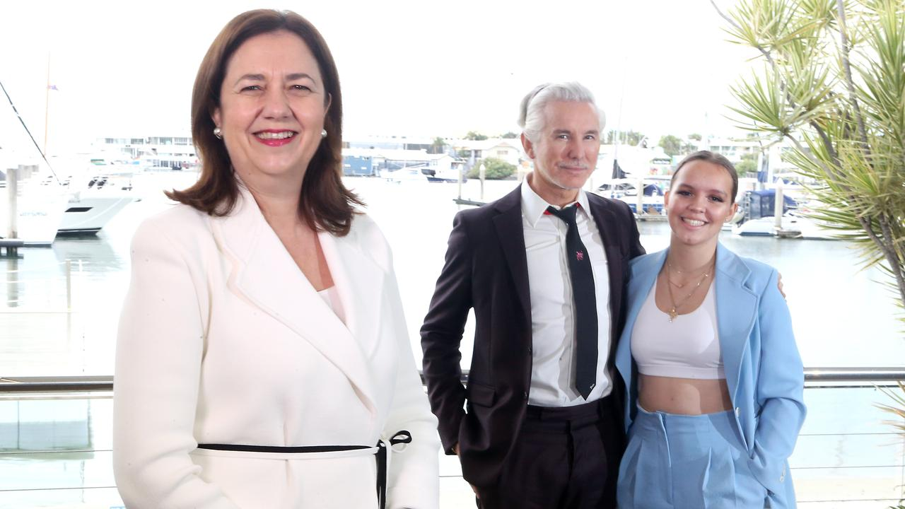 Baz Luhrmann along with daughter Lilly were at Southport Yacht Club in May to announce a COVID-19 initiative for foreign students with Premier Annastacia Palaszczuk (left). Picture: AAP Image/Richard Gosling