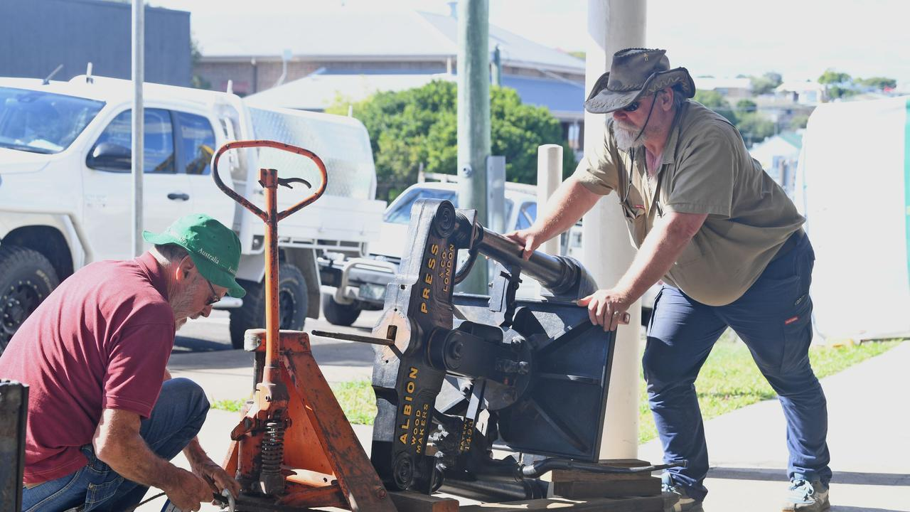 NEW ROLE: Gympie Gold Mining and Historical Museum volunteers Ralph Richardson and Frank Kopke load the old and original Gympie Times printing press, as the start of its new life.