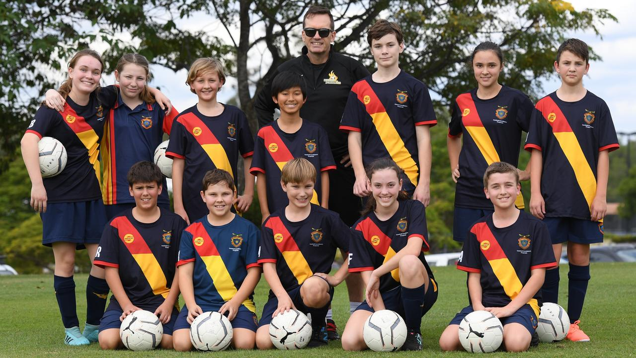 Western Pride technical director Mike Mulvey with enthusiastic students in the West Moreton Anglican College Football Excellence program. Picture: Rob Williams