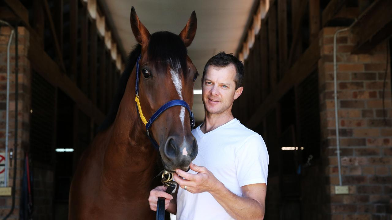 Pictured is Horse Trainer Jason Deamer with Unbeaten race horse Bon Amis, in Newcastle. Picture: Tim Hunter.