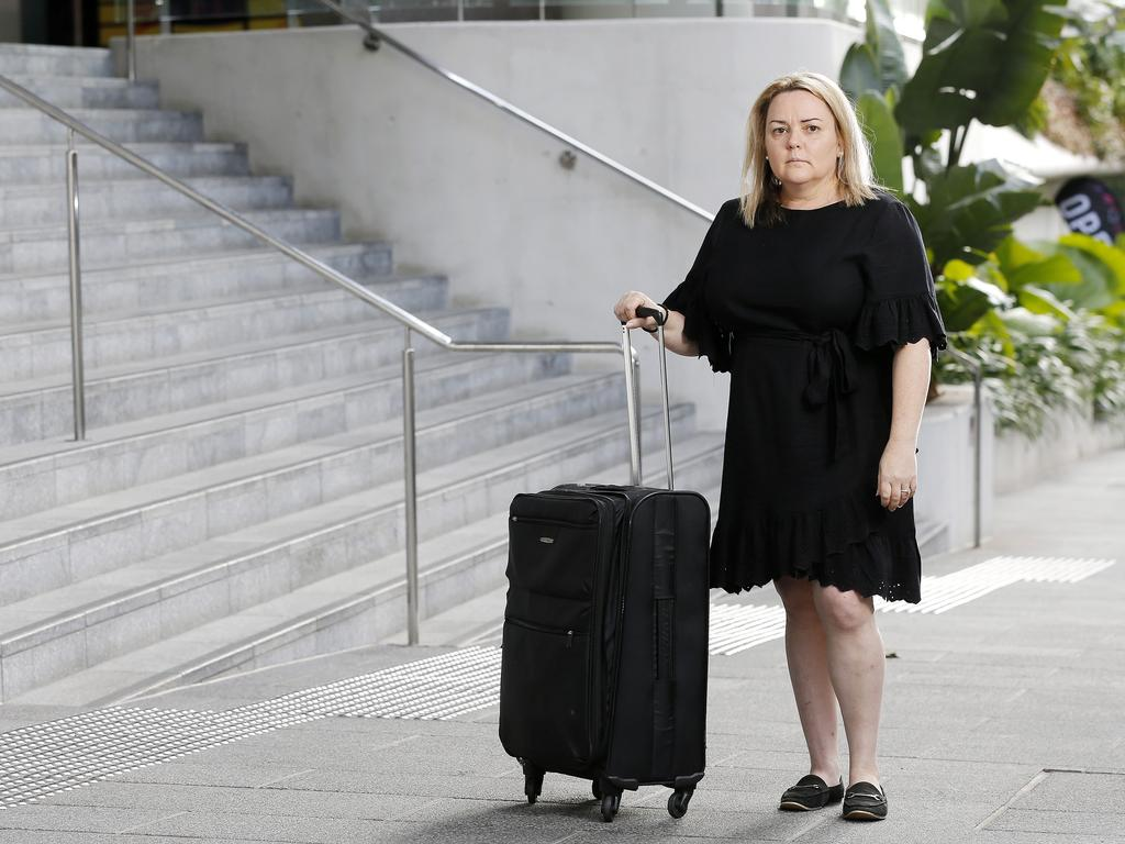 Kristina Georges posing outside Flight Centre Brisbane 11th of June 2020. Kristina is waiting on a $60,000 refund from Flight Centre after her trip to Greece was cancelled. (Image/Josh Woning)