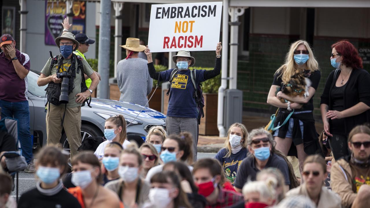Protesters participate in a