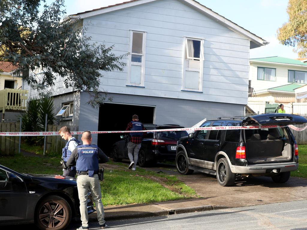 New Zealand Police guard a house after arresting two men in Auckland, New Zealand. Picture: Hannah Peters/Getty Images