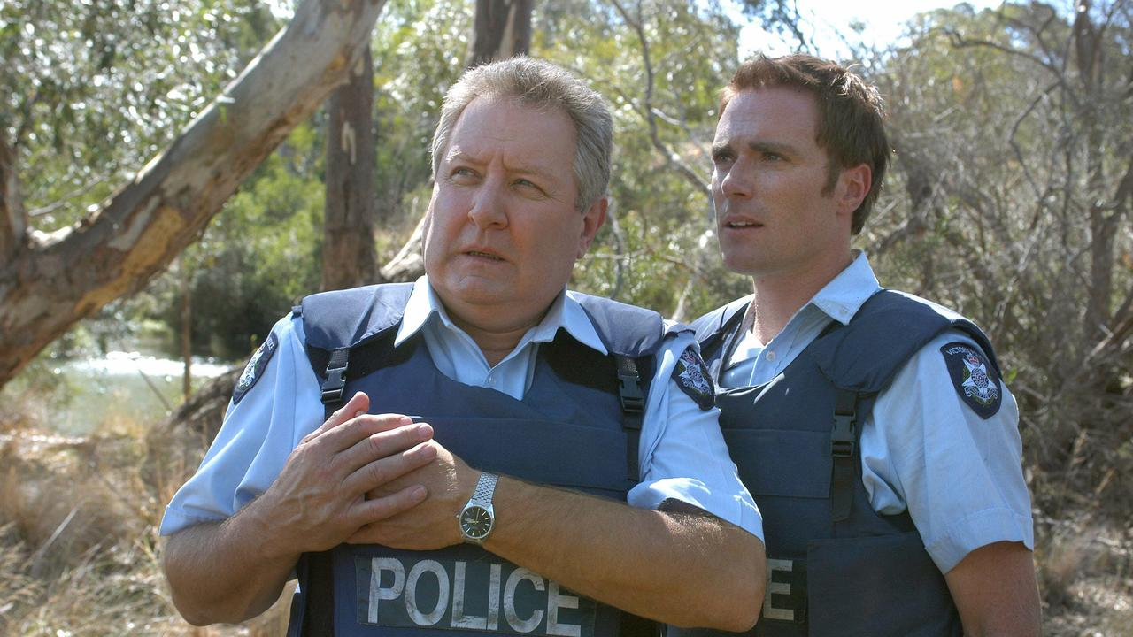 Actor John Wood with Ditch Davey in scene from Blue Heelers.
