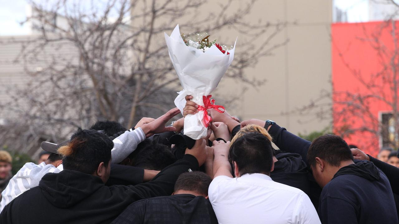 Students gathered in a huddle to farewell their friend. Picture: Wayne Taylor