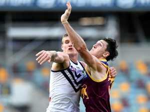 Brisbane Lions ruckman standing tall