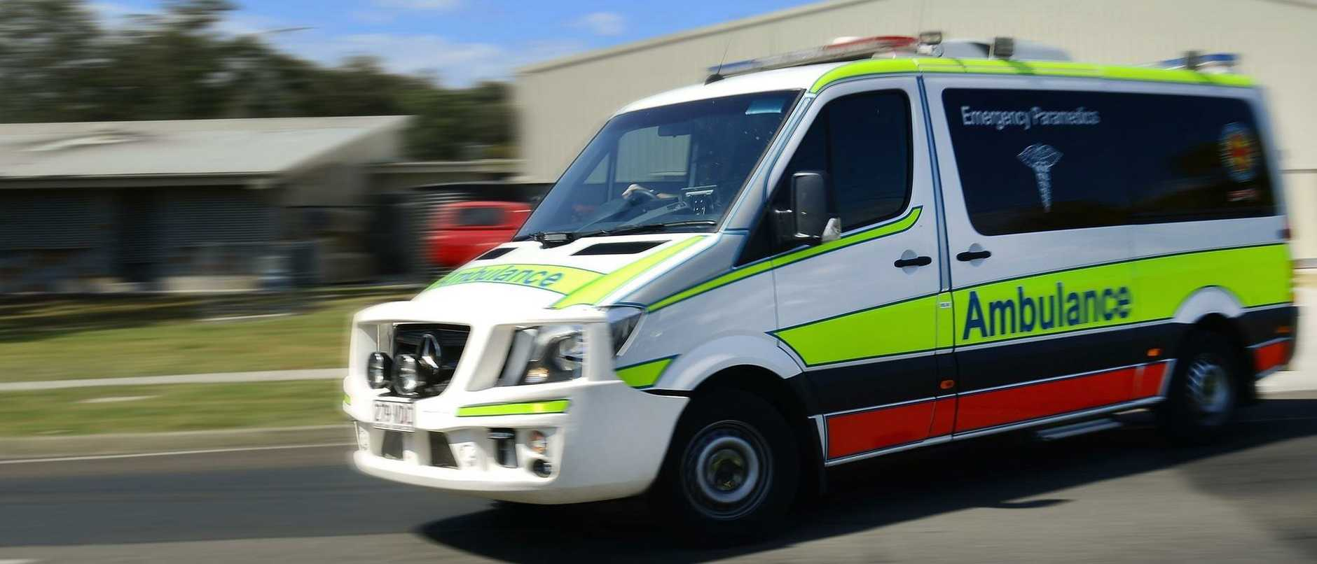 A person has been injured after a large drum fell on them at work.