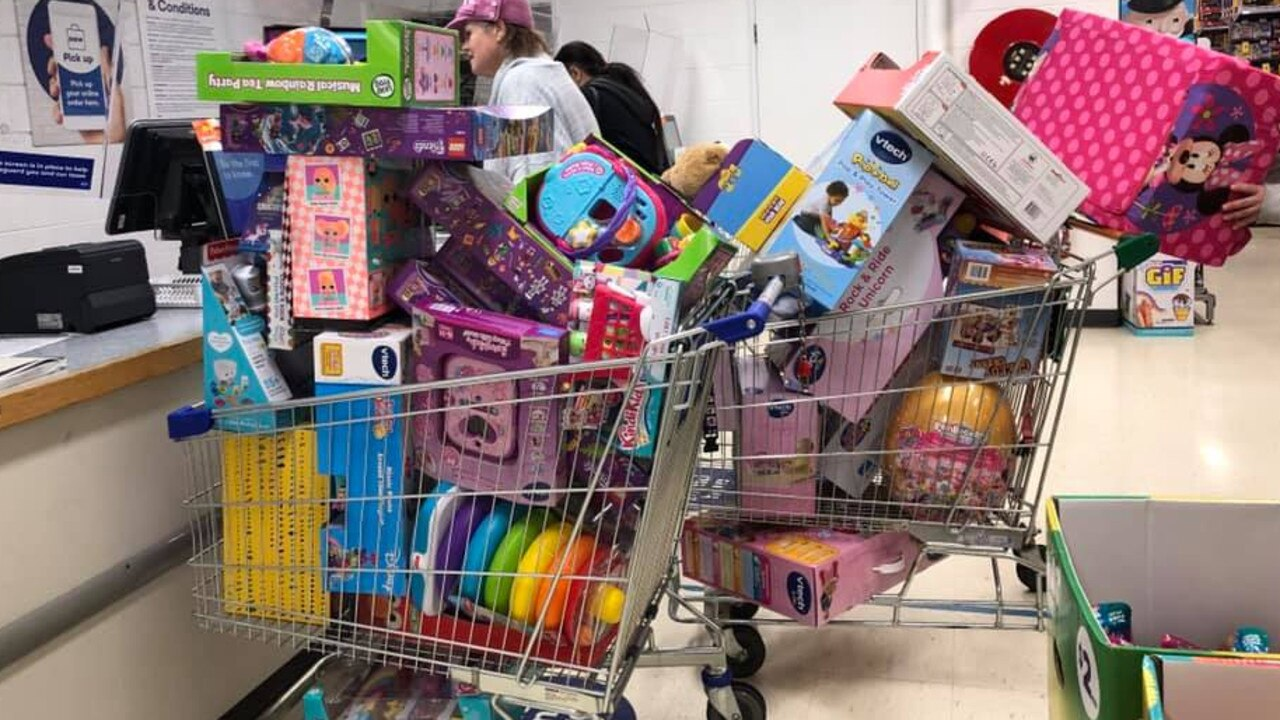 This shopper had a lot of toys to lay-by for their children.