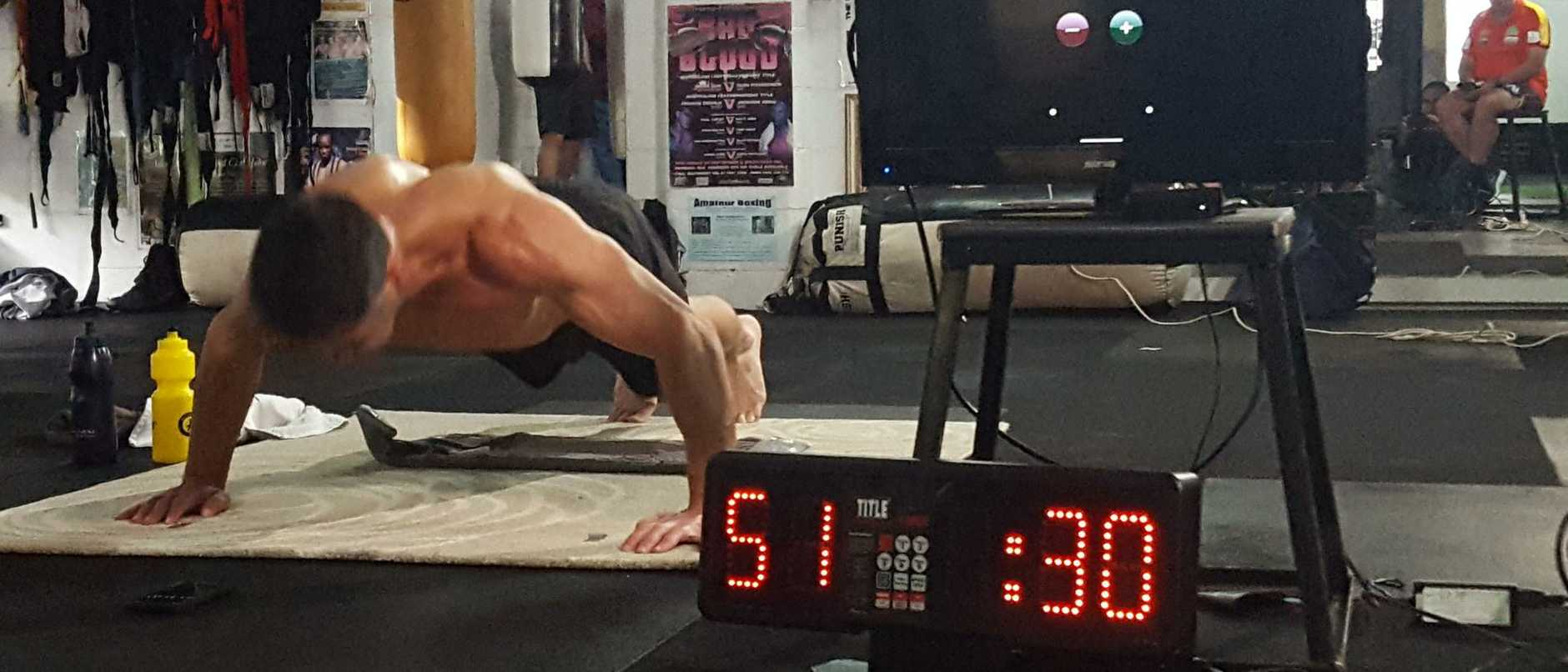 Accountant Jarrad 'Joey' Young is the undisputed push-up king of the world.