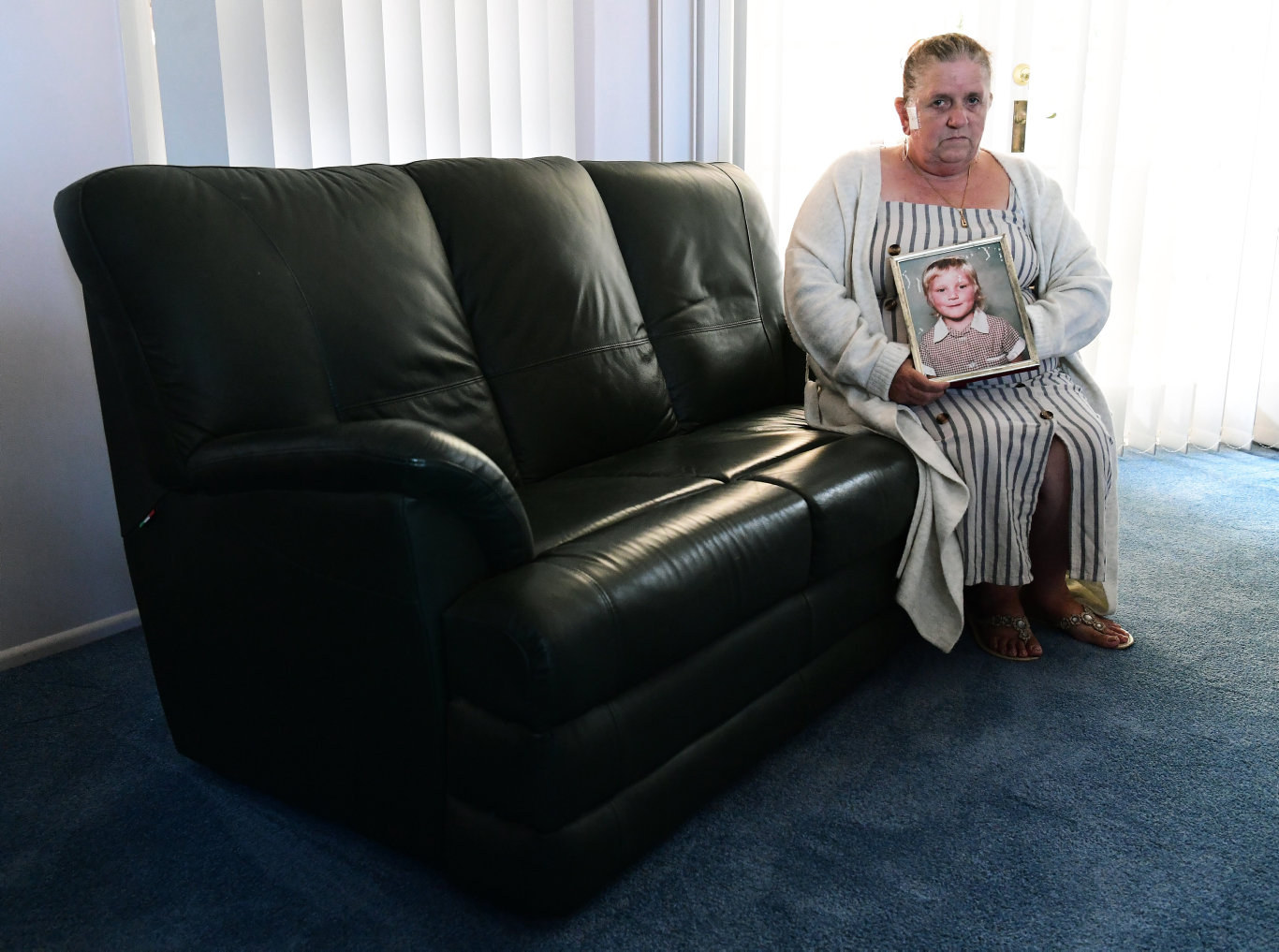 Janet Clarke holds a portrait of Stacey-Ann Tracy who was murdered 30 years ago in Roma.