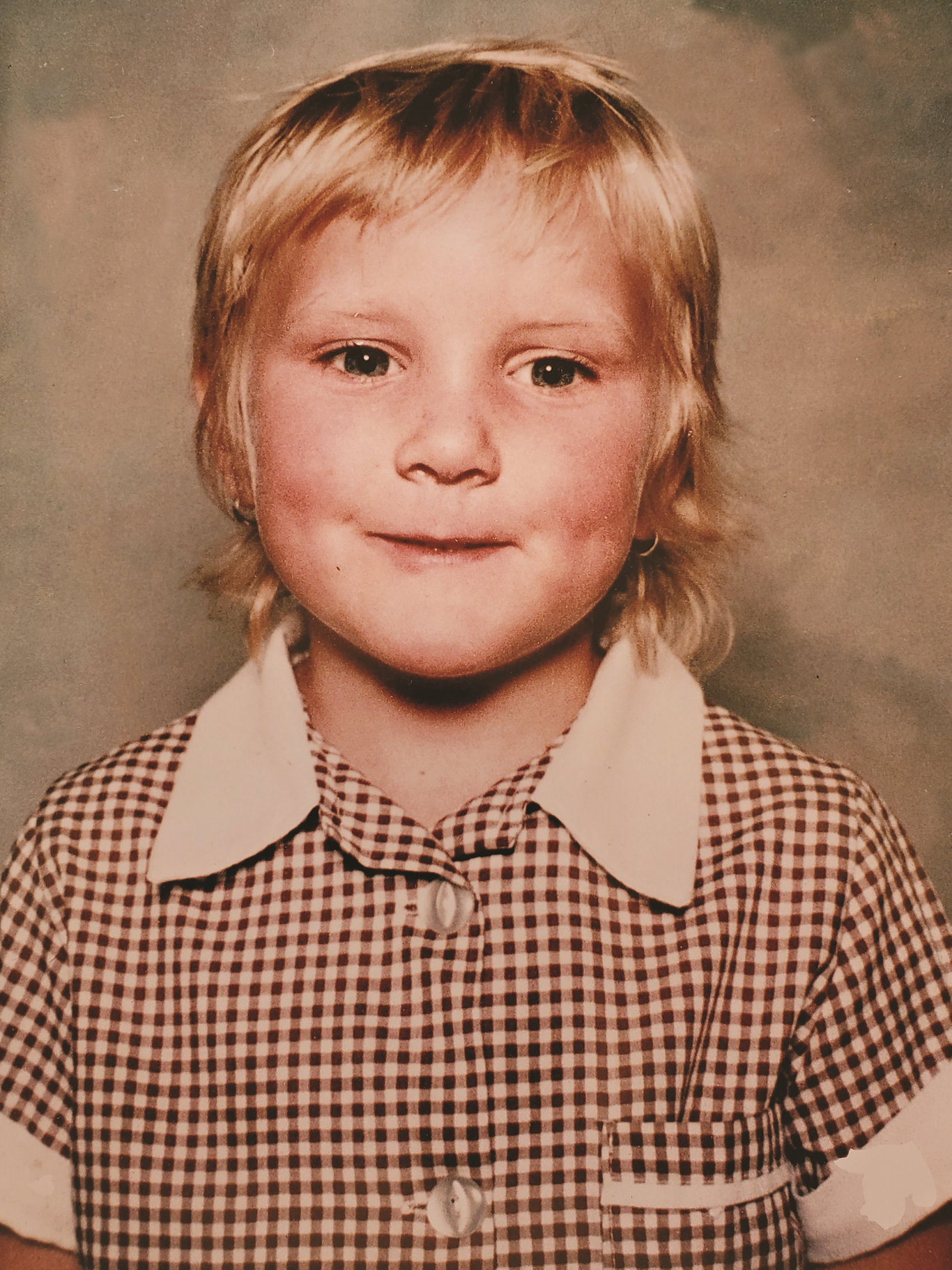 Stacey-Ann's first school photo. Just weeks before, the youngster had lovely long hair. She is pictured here with the haircut she gave herself the day before she started school. It is a memory that makes her mum Janet smile.