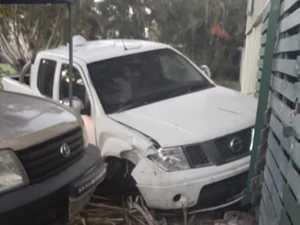 Man rams stolen car into suburban home