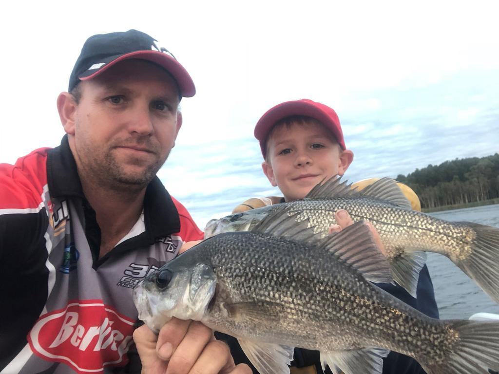 BASS ON THE BITE: Shaun Warmington and his son Bryce with the bass they caught at Lake Gregory recently.
