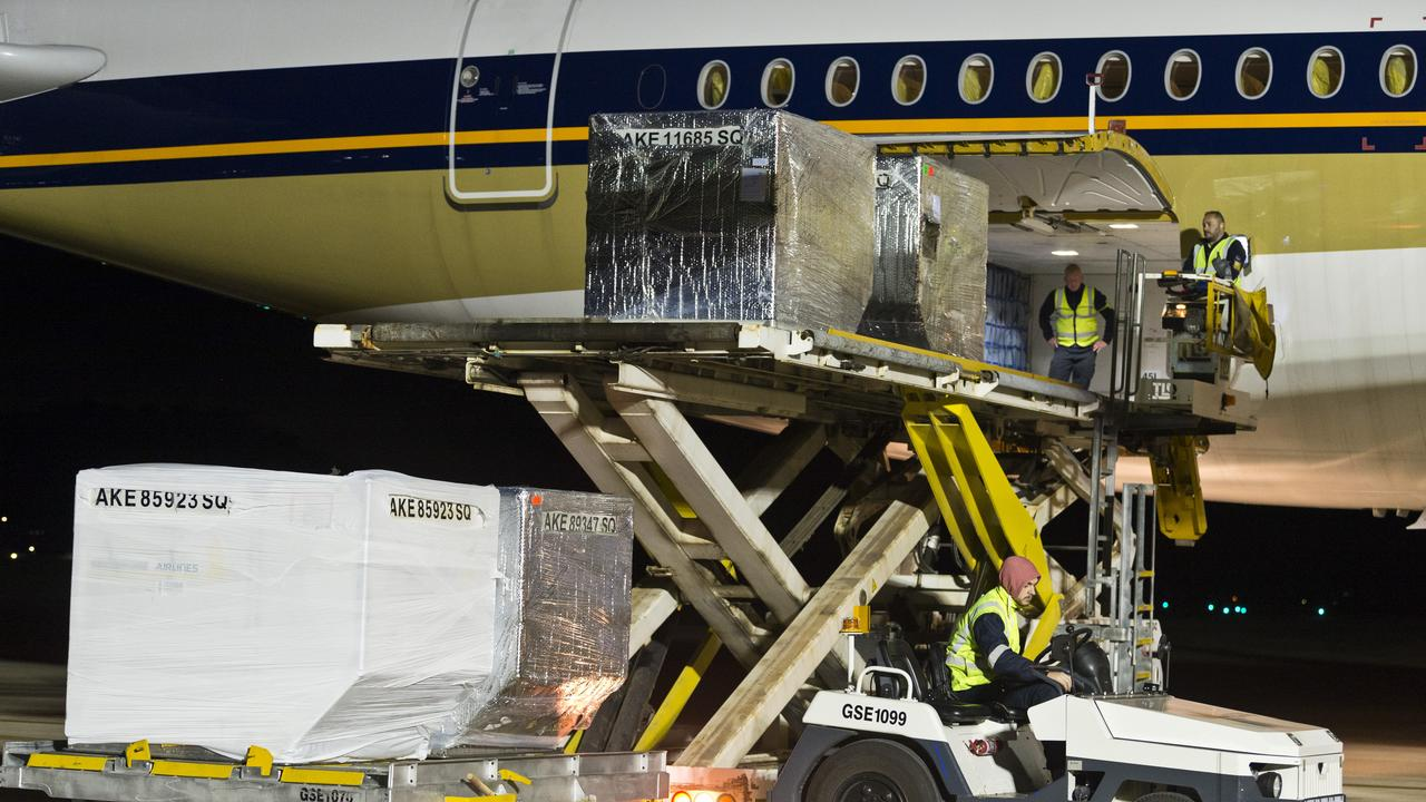 Cargo being loaded onto the first ever Singapore Airlines plane, an Airbus A350, to fly local produce from Wellcamp Airport direct to Singapore. Picture: Kevin Farmer
