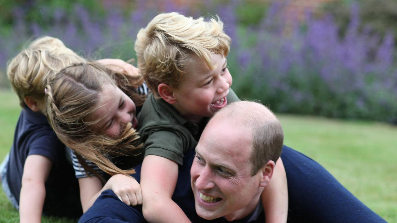 The Duke of Cambridge plays on the grass with (R-L) Prince George, Princess Charlotte and Prince Louis to mark both his birthday and Fathers Day. Picture: Kate Middleton