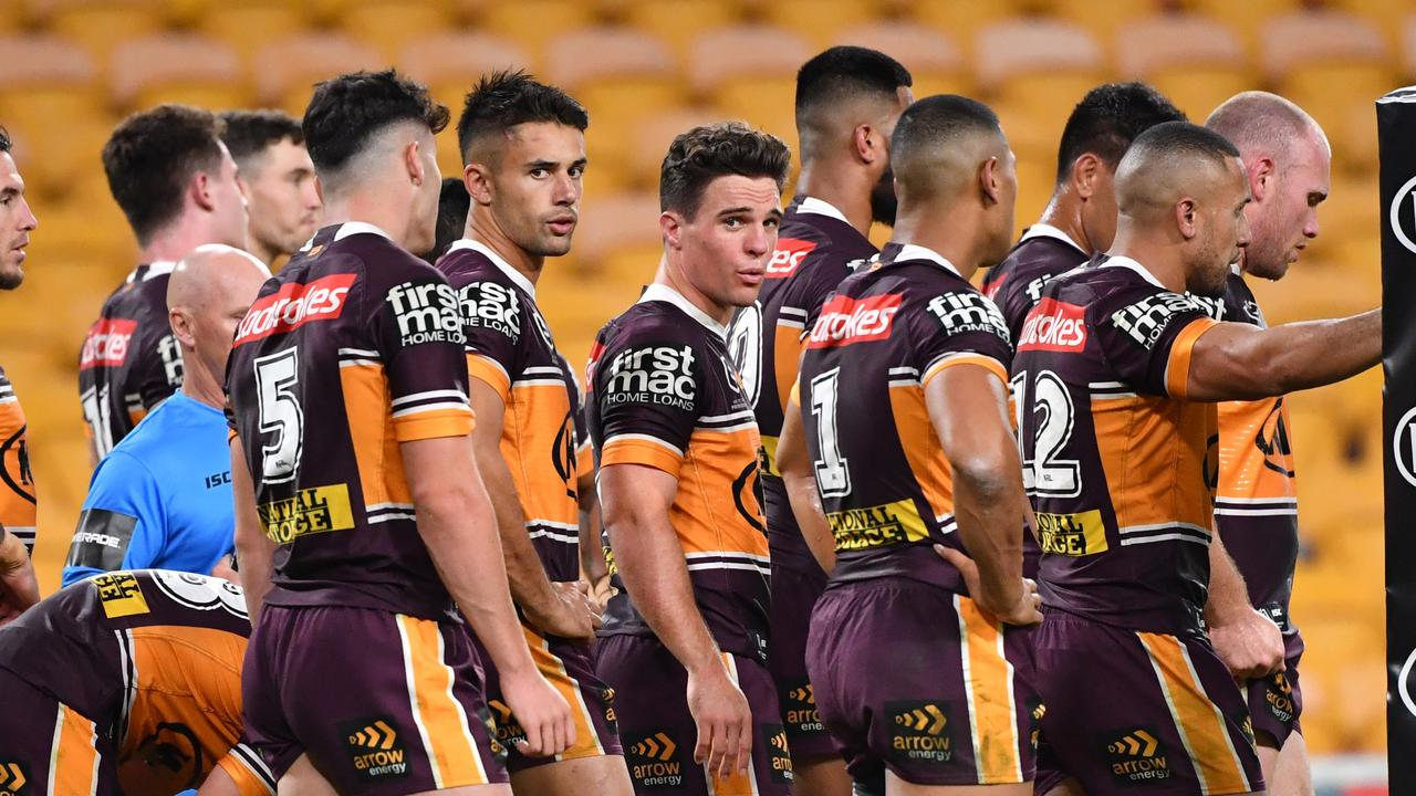 Brodie Croft (centre) of the Broncos is seen with teammates after a Luke Keary of the Roosters scored a try during the Round 4 NRL match the Brisbane Broncos and the Sydney Roosters at Suncorp Stadium in Brisbane, Thursday, June 4, 2020. (AAP Image/Darren England) NO ARCHIVING, EDITORIAL USE ONLY