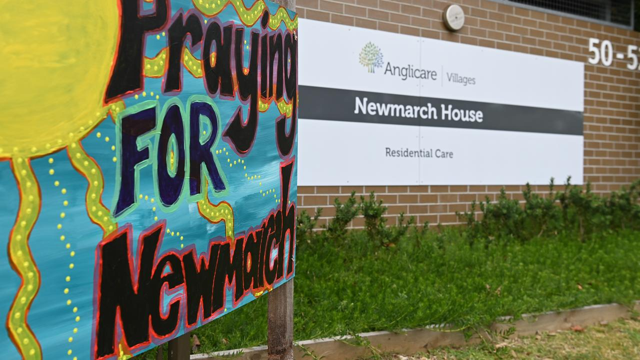 Signs and flowers left at the entrance to Newmarch House. Picture: Dean Lewins/AAP