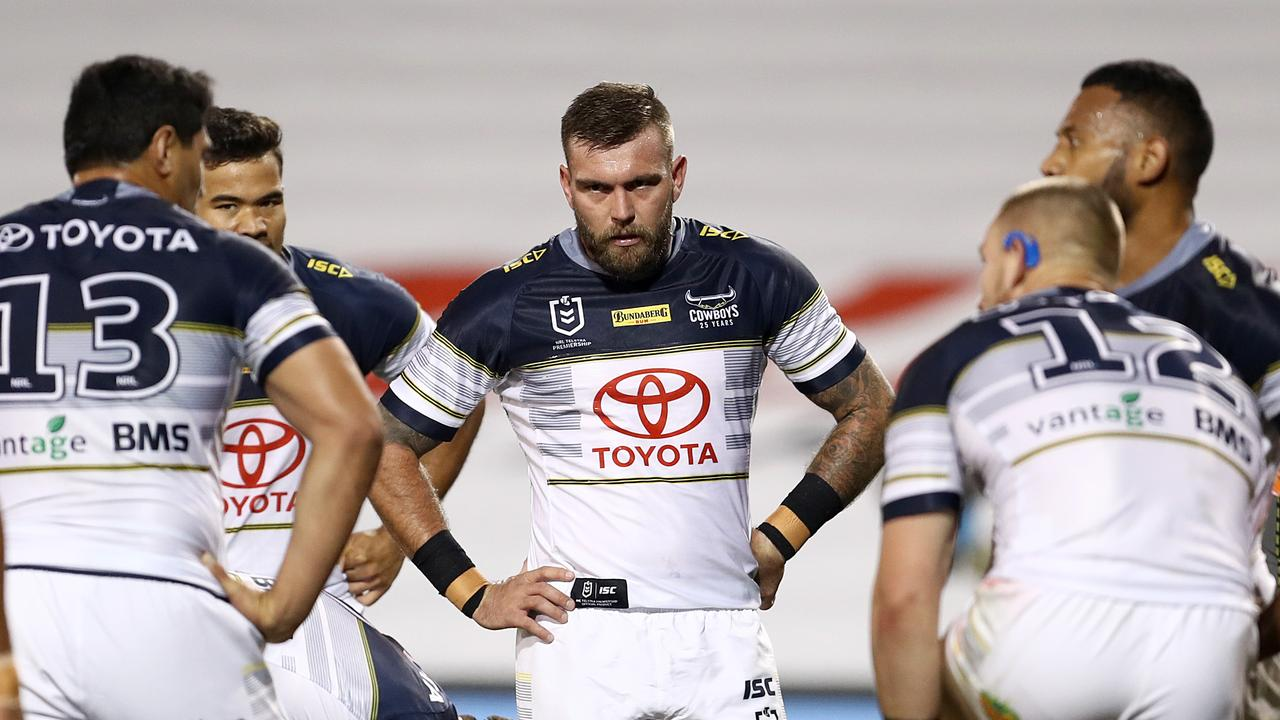 Kyle Feldt of the Cowboys (centre) looks on after a Tigers try during the Round 6 NRL match between the Wests Tigers and the North Queensland Cowboys at Campbelltown Stadium in Sydney, Saturday, June 20, 2020. (AAP Image/Brendon Thorne) NO ARCHIVING, EDITORIAL USE ONLY